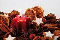 Lit candle and Christmas decoration