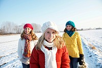 Teenage girls walking in a snow covered landscape