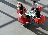 Four business colleagues holding a business meeting