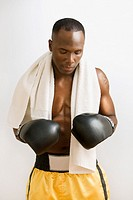 African boxer in boxing gloves and towel