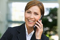 headshot of mature businesswoman talking on mobile phone
