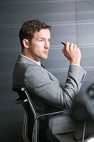 profile of businessman sitting in office chair