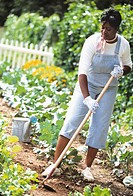 African woman working in vegetable garden