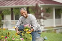 Senior African man gardening