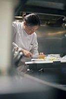 Asian female chef working in kitchen