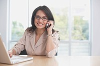 Hispanic businesswoman talking on cell phone