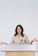 Hispanic businesswoman giving presentation