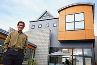 Man standing in front of house (thumbnail)
