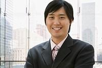 Close up of Asian businessman smiling