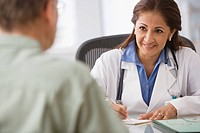Hispanic female doctor talking to patient (thumbnail)