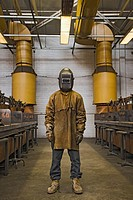 Japanese welder posing in protective gear
