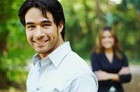 Hispanic businessman posing outdoors