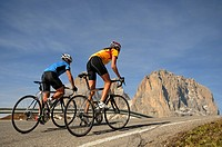 Rear view of two mountain bikers cycling together, Dolomites, Italy