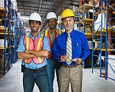 Multi_ethnic co_workers in warehouse