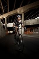 Man riding bike in urban area