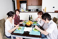 Two young couples dining