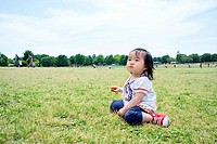 A girl sitting on the grass