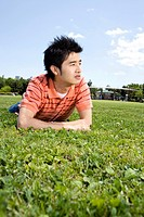 Young man lying on the grass (thumbnail)
