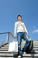 Young man with the shopping bags