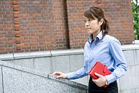 Business woman with book (thumbnail)