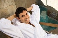 Portrait of man in bathrobe relaxing outdoors