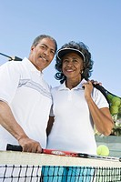 Couple with tennis equipment portrait