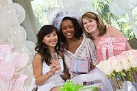 Bride with friends celebrating bridal shower