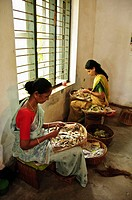 Woman rolling Beedis in a Factory     Kerala, India