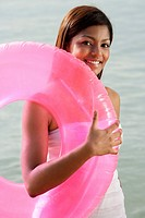 woman at beach with pink tube