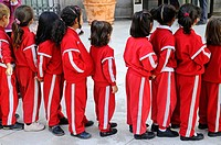 Children in sports gear, forming a line, Madrid, Spain, kindergartners, school children, jogging suit, uniform