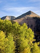 Mount Tukuhnikivatz rises above golden aspens on a fall afternoon in the La Sal mountains outside Moab, Utah