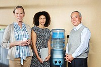Portrait of co_workers by water cooler