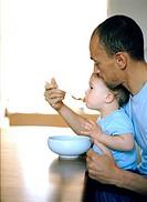 Father feeding Son