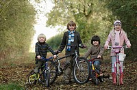 Children with bikes on country lane