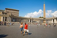Tourists, obelisk and colonnade, Saint Peter&#8217;s Square, Piazza San Pietro, Vatican City, Rome, Italy