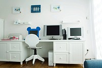 Assorted computer monitors on desk in home office