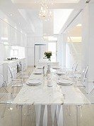 View down marble dining table into kitchen