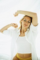 Woman waking up, stretching