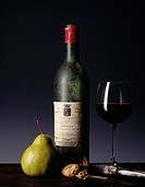 Bottle of old Bordeaux red wine,pear and walnuts