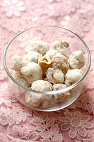 Hazelnuts covered with icing sugar