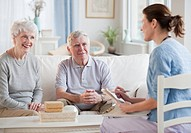 Nurse talking to senior adults