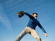 Baseball player throwing ball