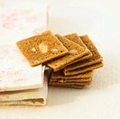 Pile of square almond biscuits (thumbnail)