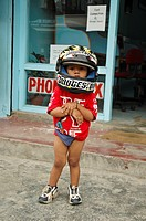 Toddler wearing a motorcycle helmet  Pokhara, Nepal