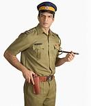 Portrait of a policeman holding a handgun