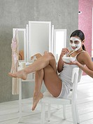 Woman in white underwear with curd mask