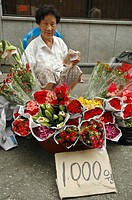 A woman selling flowers in Seoul, South Korea