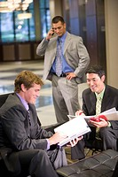 Portrait of multi_ethnic businessmen in modern lobby