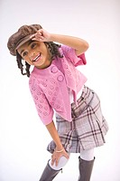 Portrait of young stylish African American girl, studio shot