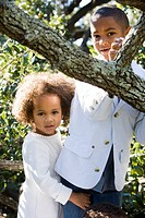 Portrait of African American children standing near tree